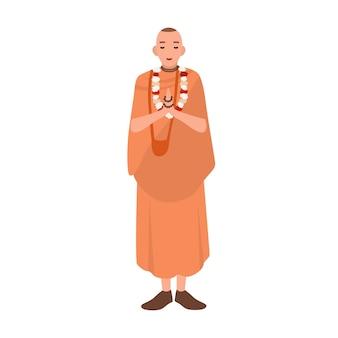 Vaishnav ou krishnait vestido com roupas tradicionais em pé e orando. clérigo, clérigo ou líder religioso