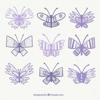 Variedade de borboletas desenhadas à mão