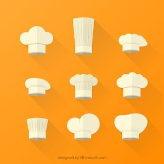Variedade de cozinheiro chefe chapéus brancos
