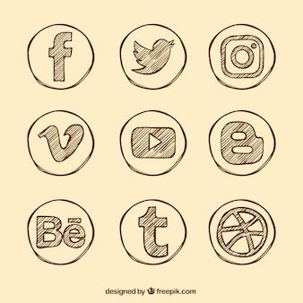 Variedade de mão desenhada ícones sociais dos media Vetor grátis