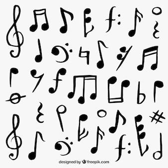 Variedade de notas musicais desenhados à mão