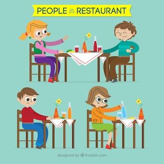 Variedade de pessoas felizes no restaurante