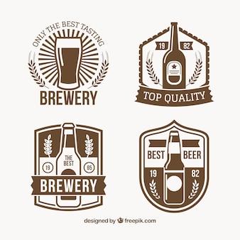 Variedade de quatro etiquetas da cerveja do vintage