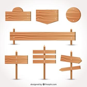 Variedade de sinais de madeira em design plano