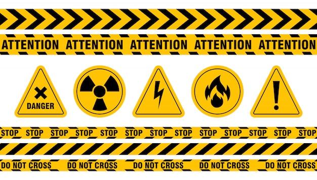 Vários conjuntos de fitas e sinais de perigo