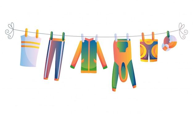 Vários itens de roupas de criança na ilustração vetorial de corda isolada