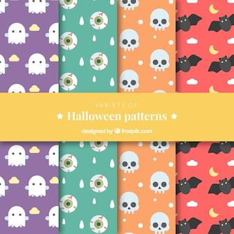 Vários padrões de cores com elementos do dia das bruxas em design plano