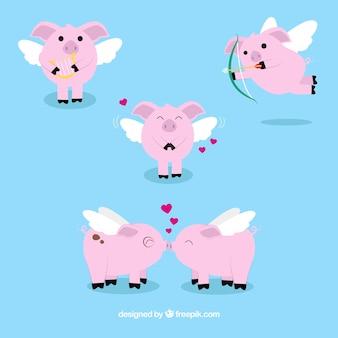 Vários porcos pequenos com asas de valentine
