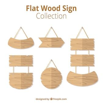 Vários sinais de madeira no design plano