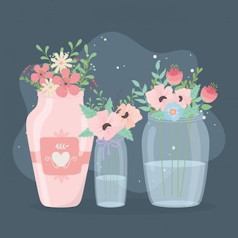 Vasos de vidro e decoração de flores de cerâmica