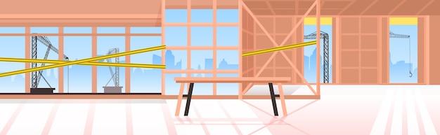 Vazio, sem pessoas, local de construção com fitas amarelas conceito de serviço de reparo edifício interior horizontal