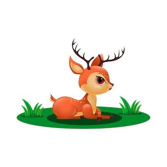 Veado fofinho sentado na grama
