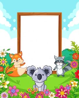 Vector a ilustração de animais fofos com sinal em branco de madeira no parque
