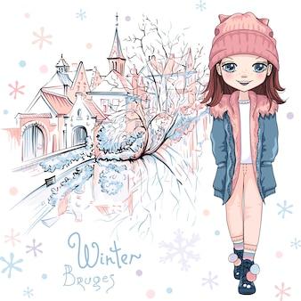 Vector cute baby girl com roupas de inverno no canal de bruges com belas casas medievais e uma igreja em bruges, bélgica