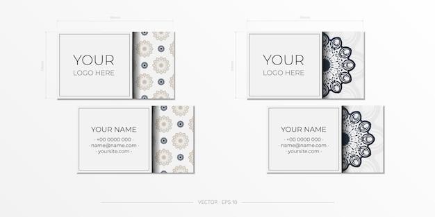Vector design de cartão de visita de cor branca com ornamento vintage preto. cartões de visita elegantes com padrões gregos.