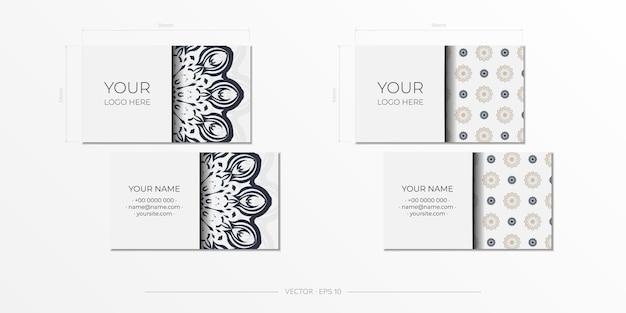 Vector design de cartão de visita de cor branca pronto para imprimir com padrões vintage pretos. modelo de cartão com ornamento grego.