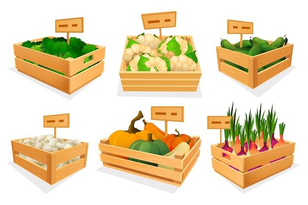 Vegetais frescos em caixas de madeira para venda