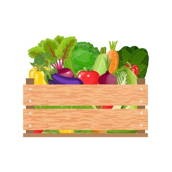 Vegetais saudáveis recém-colhidos em uma caixa de madeira e mercearia