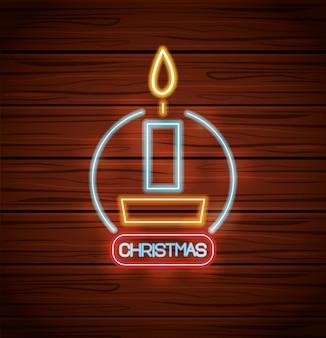 Vela de feliz natal com luzes de neon na madeira