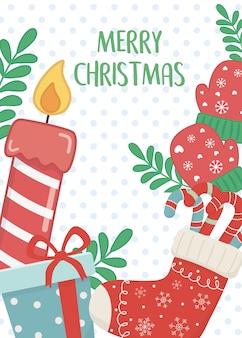 Vela meias presente e luvas cartão de feliz natal
