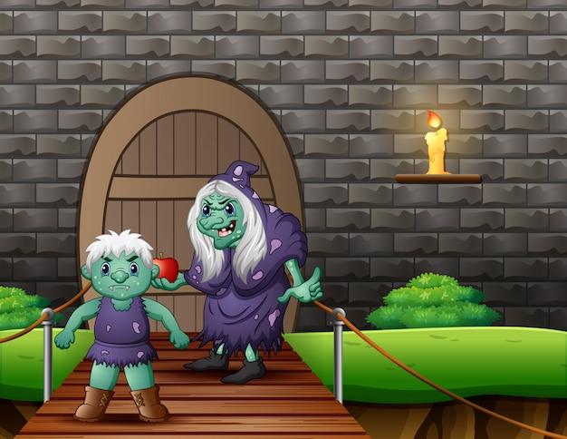 Velha bruxa malvada com um gigante na frente da casa