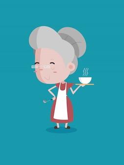 Velha mulher cozinhar segure o equipamento de cozinha e um copo