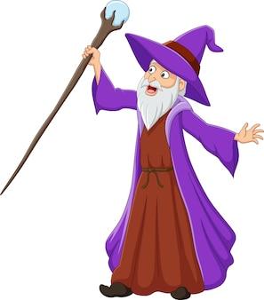 Velho bruxo de desenho animado segurando uma vara mágica