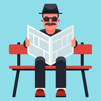 Velho homem com um chapéu lendo um jornal