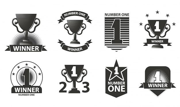 Vencedores logotipos, distintivos, emblemas