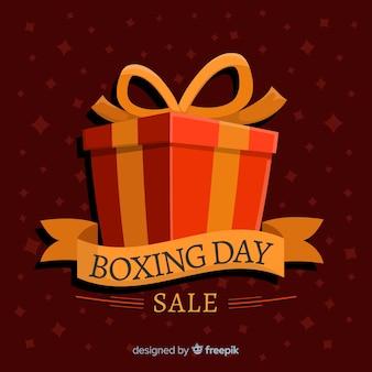 Venda de dia de boxe plana com caixa de presente embrulhada e fita