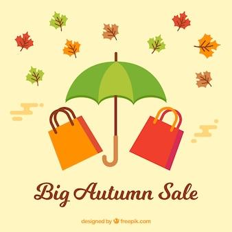 Venda de outono com sacolas de compras e guarda-chuva