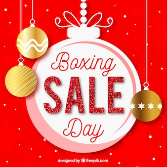 Venda do dia do boxe escrita em uma grande bola de natal