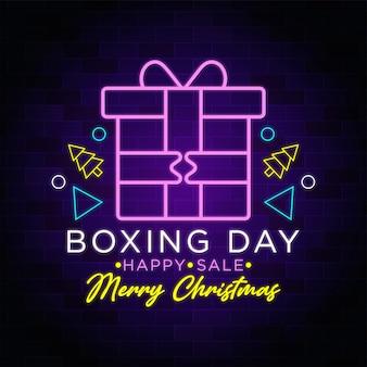 Venda feliz de boxing day - texto em néon feliz natal com caixa de presente de natal