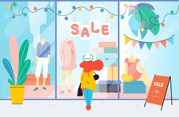 Venda. menina olha para a janela da loja de roupas. mulher em pé perto de vitrine no shopping. desconto