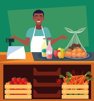 Vendedor com vitrine de loja com alimentos frescos