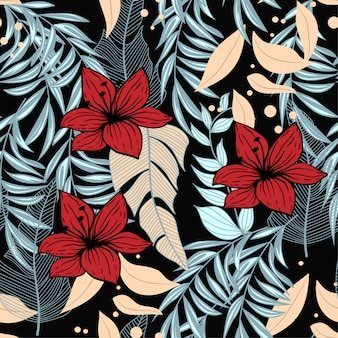 Verão abstrata padrão sem emenda com folhas tropicais coloridas e plantas em fundo preto