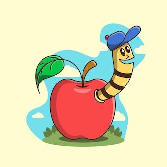 Verme fofo com chapéu azul na maçã vermelha