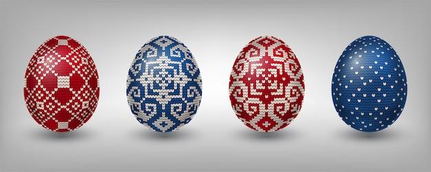 Vermelho e azul paschal ovos com padrões de tricô