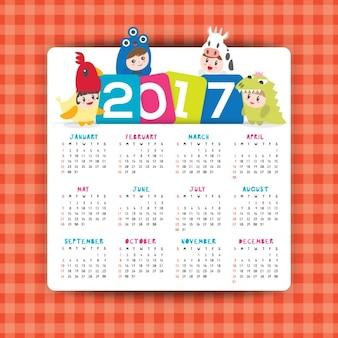 Vetor 2017 calendário com ilustração dos desenhos animados de crianças na semana traje começa a partir de domingo