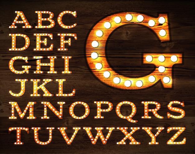 Vetor de cartas no alfabeto de lâmpada velha estilo retro