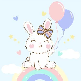 Vetor de coelho bebê fofo sente-se no arco-íris com balões