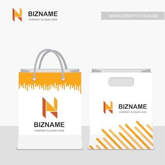 Vetor de design de sacos de compras da empresa