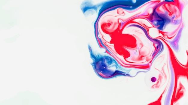 Vetor de fundo de arte abstrato fluido azul vermelho e rosa