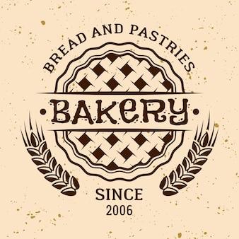 Vetor vintage de padaria redondo emblema, etiqueta, distintivo ou logotipo com torta e trigo em fundo de cor clara