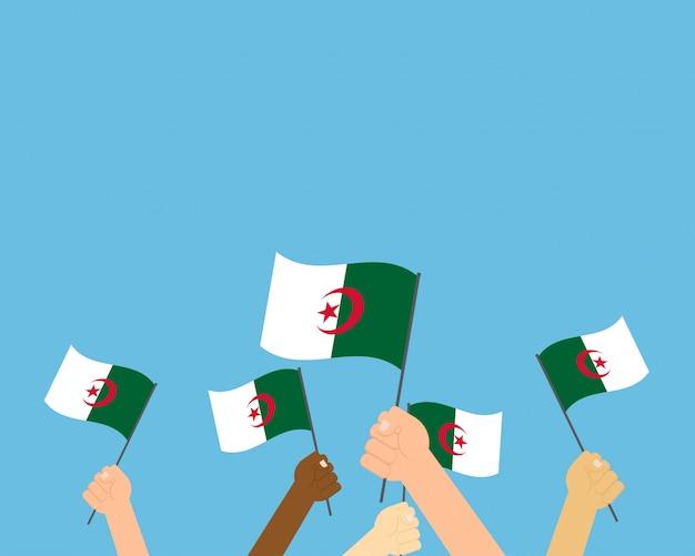 Vetorial, ilustração, de, mãos, segurando, argélia, bandeiras