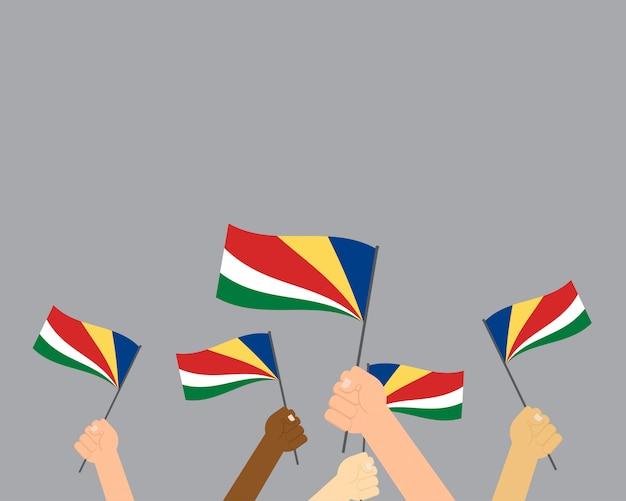 Vetorial, ilustração, de, mãos, segurando, bandeiras seychelles