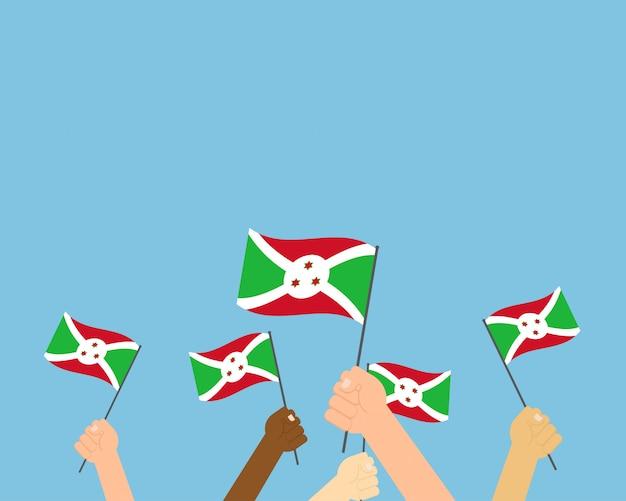 Vetorial, ilustração, de, mãos, segurando, burundi, bandeiras