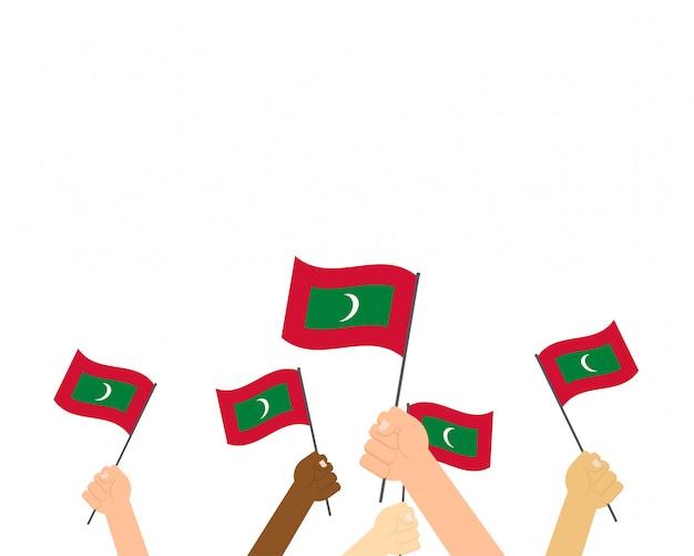 Vetorial, ilustração, de, mãos, segurando, maldives, bandeiras