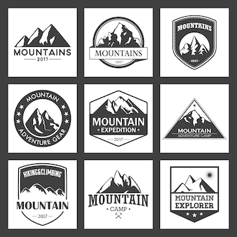 Viagens de montanha, conjunto de logotipo de aventuras ao ar livre. insígnias de caminhadas e escaladas para organizações de turismo, eventos, lazer de acampamento.