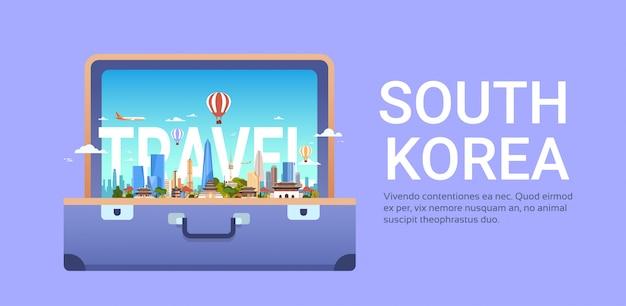 Viajar para a coreia do sul com a paisagem da cidade de seul em vista do horizonte de mala